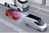 A red car with sensors braking behind a white