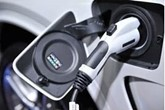 Electric vehicle charger plugged into car