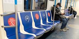 Passenger wearing mask on metro train