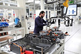 Man working on battery production in a factory