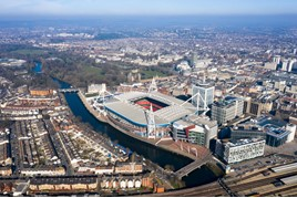 Cardiff aerial view Wales capital cityscape panoramic skyline feat. River Taff and city center in UK with Principality Stadium home of Welsh rugby union, plus football around town center from above.