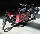 Red and black Pedal Me cargo bike
