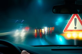 Cars at night with brake lights on