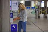 Hand sanitiser point at station