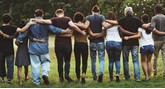 People in a line with arms around each other