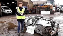 Mayor Andy Street with the crushed Citroen at Mainline Salvage car recycling centre in Wolverhampton