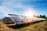 Brightly coloured solar panels under blue sky