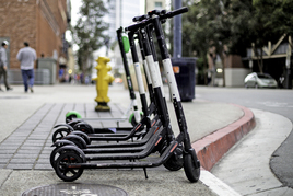 Row of e-scooters for hire