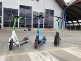 Row of three e-scooters