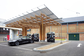 TfL rapid charging hub at Glass Yard in Woolwich with car charging in the foreground
