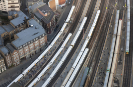 Overhead view of a busy railway station with many lines leading into it