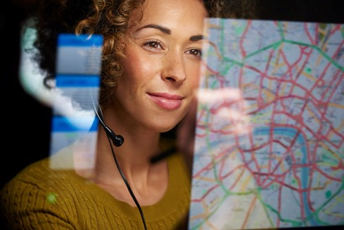 Woman looking at a map on screen