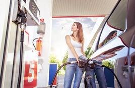 Woman refuelling car