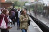 Female passenger at rail station